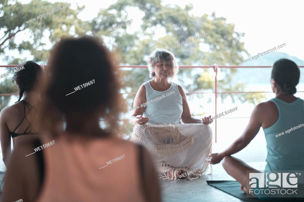 Stock Photo: Group of people meditating in the morning. Yoga retreat in Mexico.