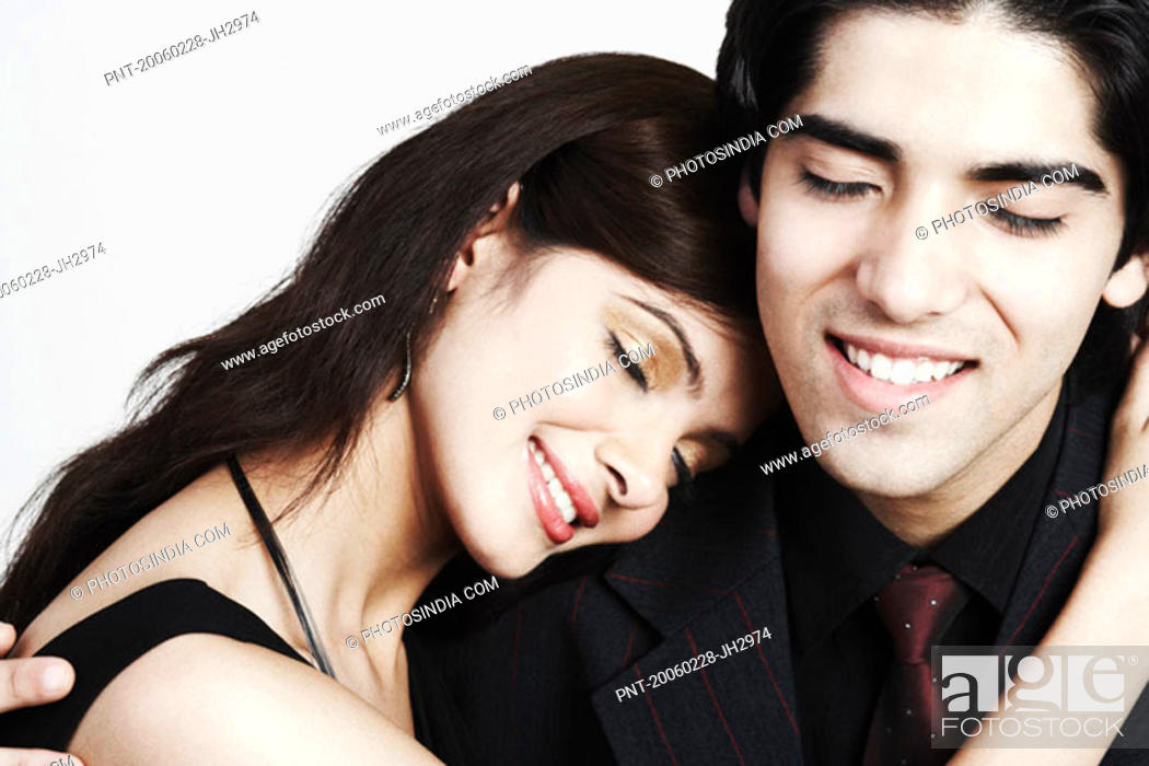 Stock Photo: Close-up of a young couple embracing each other.
