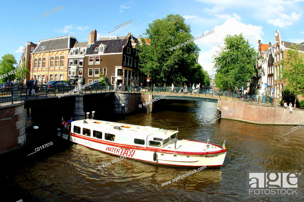 Stock Photo: Water-taxi on canal. Amsterdam. Holland.