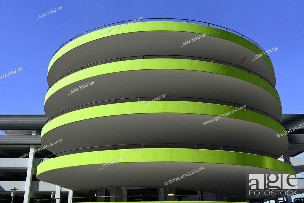 Stock Photo: A downtown, circular, green, parking garage, Kitchener, Ontario, Canada.