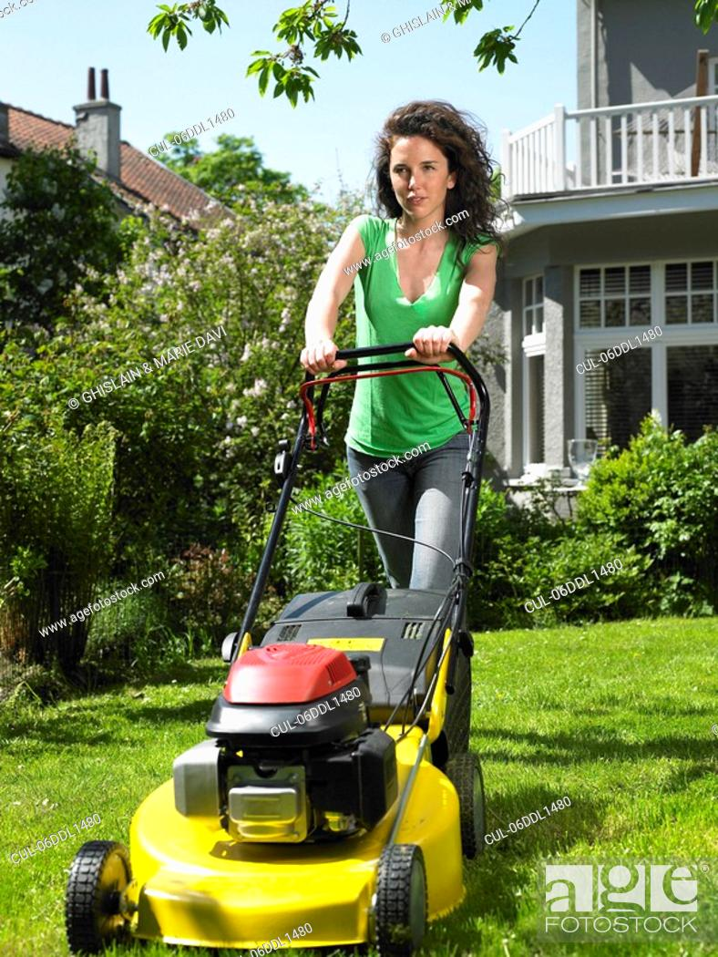 Young Woman Mowing The Lawn Stock-Foto - Getty Images