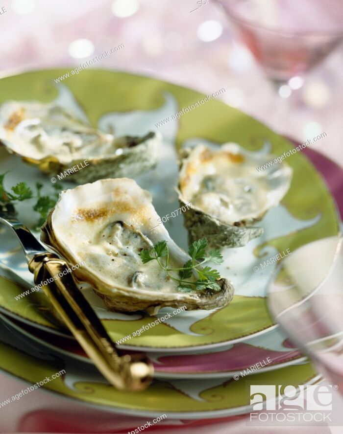 Stock Photo: browned oysters with champagne.