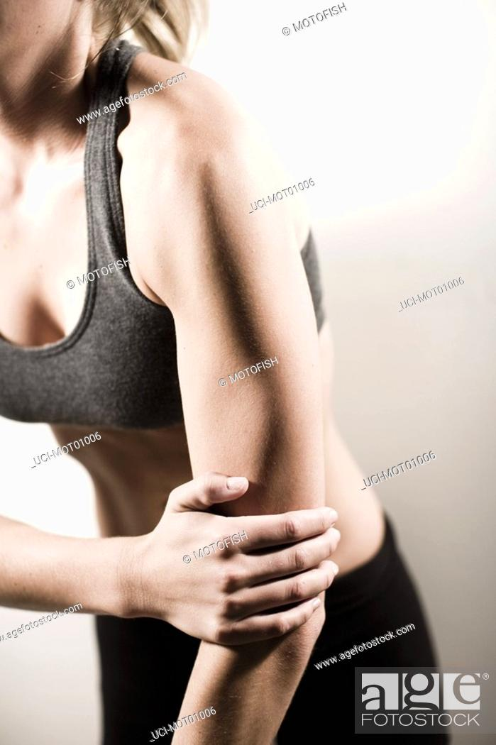 Stock Photo: Woman with hand on elbow.