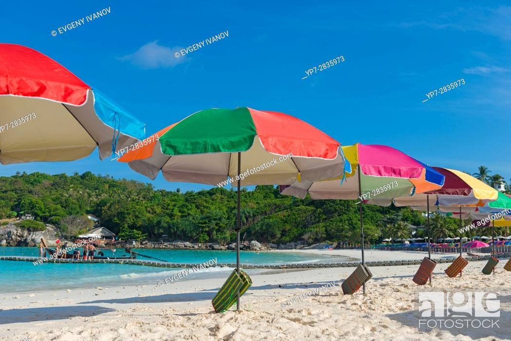 Stock Photo: Beach umbrellas waiting for tourists in Raya island, Thailand.