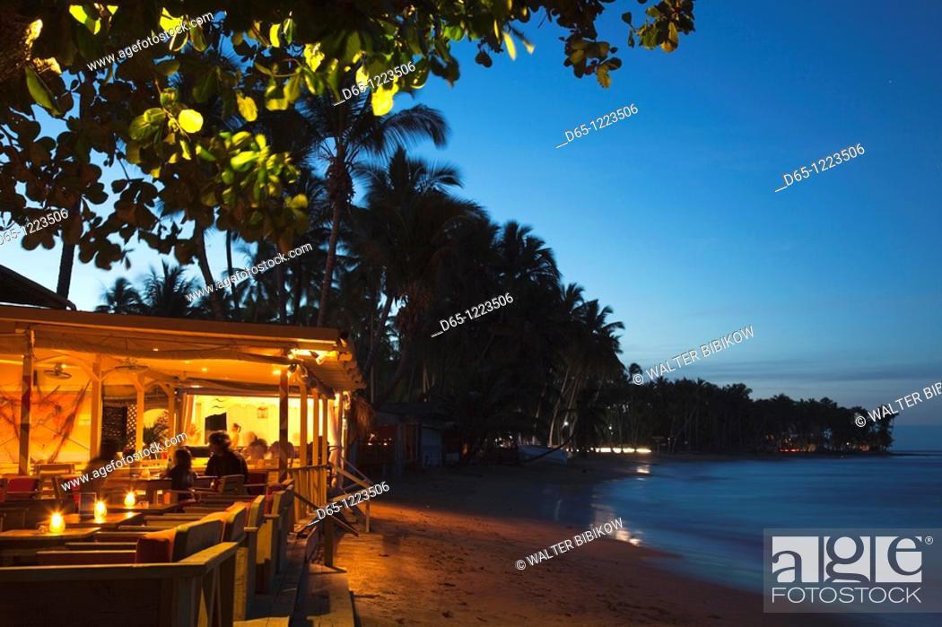 Stock Photo: Dominican Republic, Samana Peninsula, Las Terrenas, Playa Las Terrenas beach, beach bar, evening.