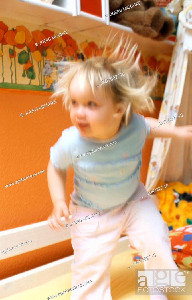 Stock Photo: A little girl, 1-5 years old, playing in the nursery.