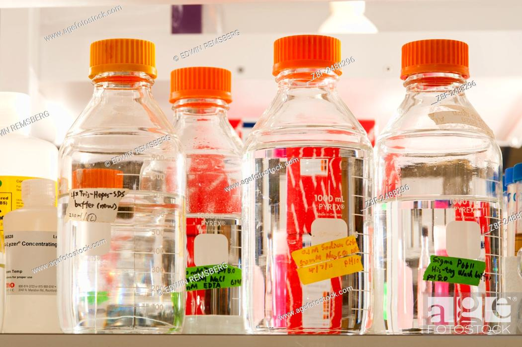 Stock Photo: Lab bottles with clear liquid and orange lids in a science lab in College Park, Maryland. USA.