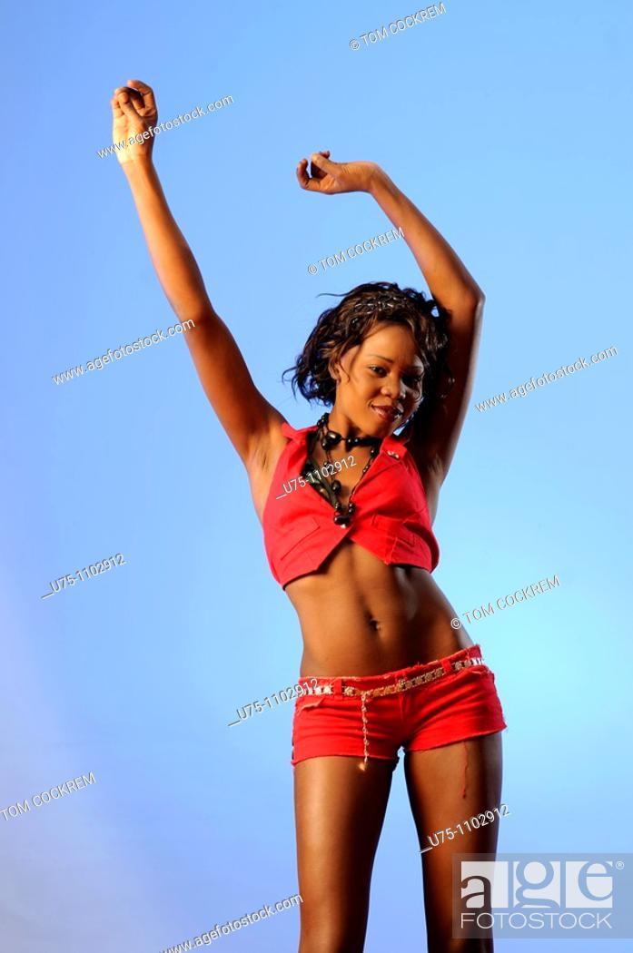 Stock Photo: black african girl in dance pose.