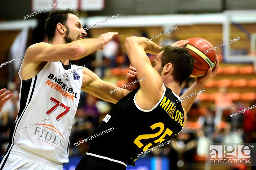 Stock Photo: Vojtech Hruban of Nymburk, left, and Vladimir Mihailovic of Ostende in action during the European Men's Basketball Cup 6th round D group game played in Nymburk.