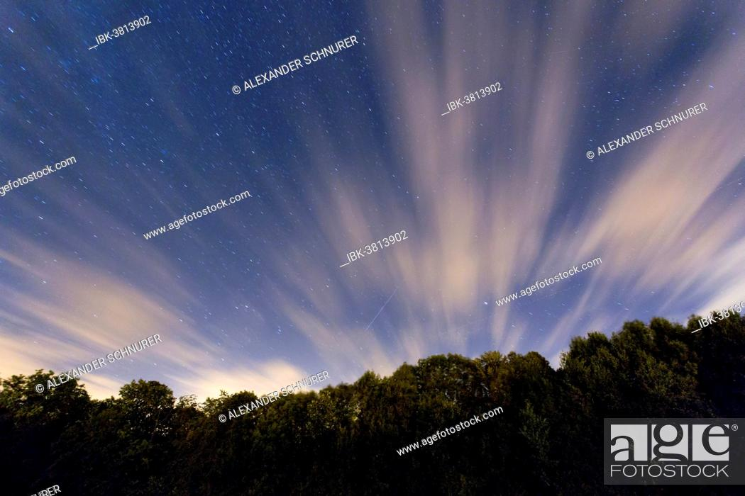 Stock Photo: Perseid meteor shower in the night sky.