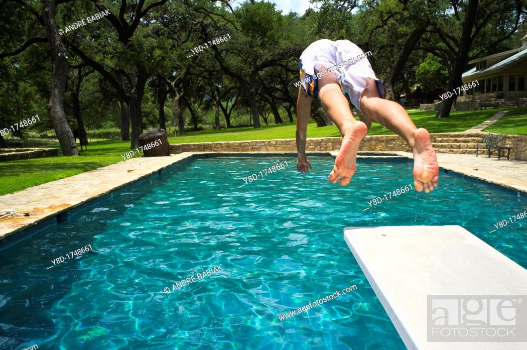 Young man, 17 years old, caucasian, jumping from diving ...
