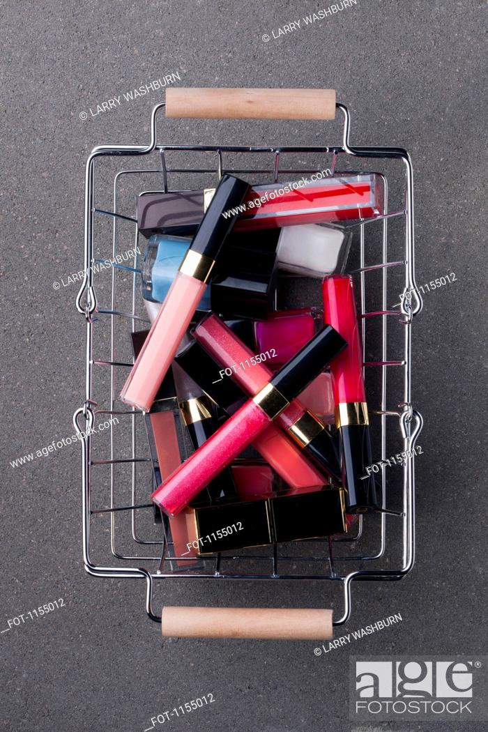 Stock Photo: Cosmetics in shopping basket.
