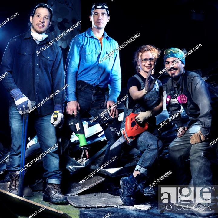 Stock Photo: Portrait of a group of people with tools at construction site doing renovations and demolition.