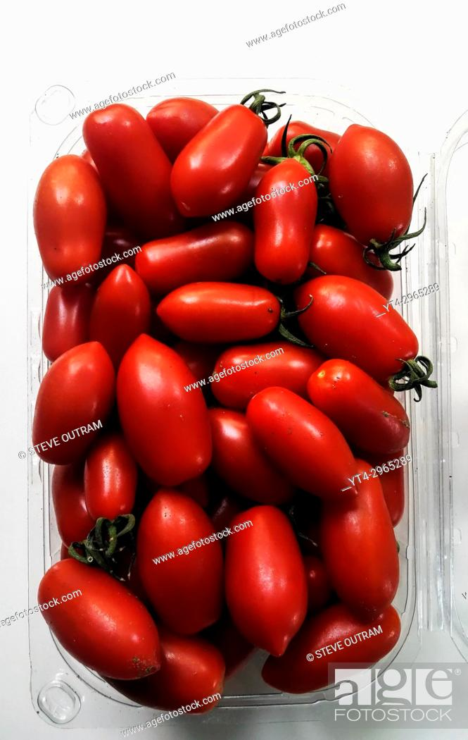 Stock Photo: Carton of biologically grown Tomatoes.