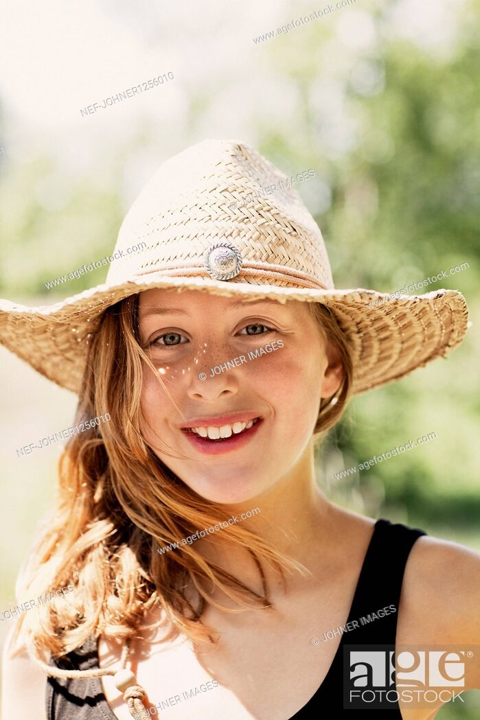 Stock Photo: Portrait of smiling girl wearing hat.