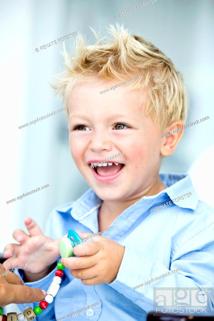 Stock Photo: Germany, Close up of boy, smiling.
