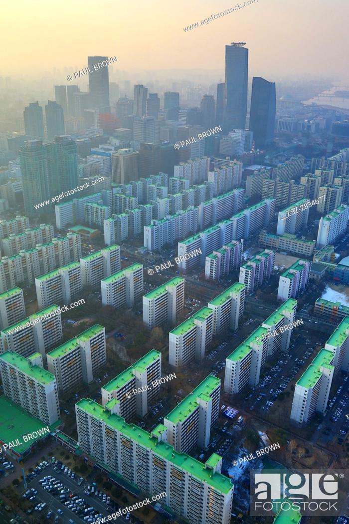 Stock Photo: General view of blocks of flats and the Seoul city skyline at dusk in Seoul, Korea.