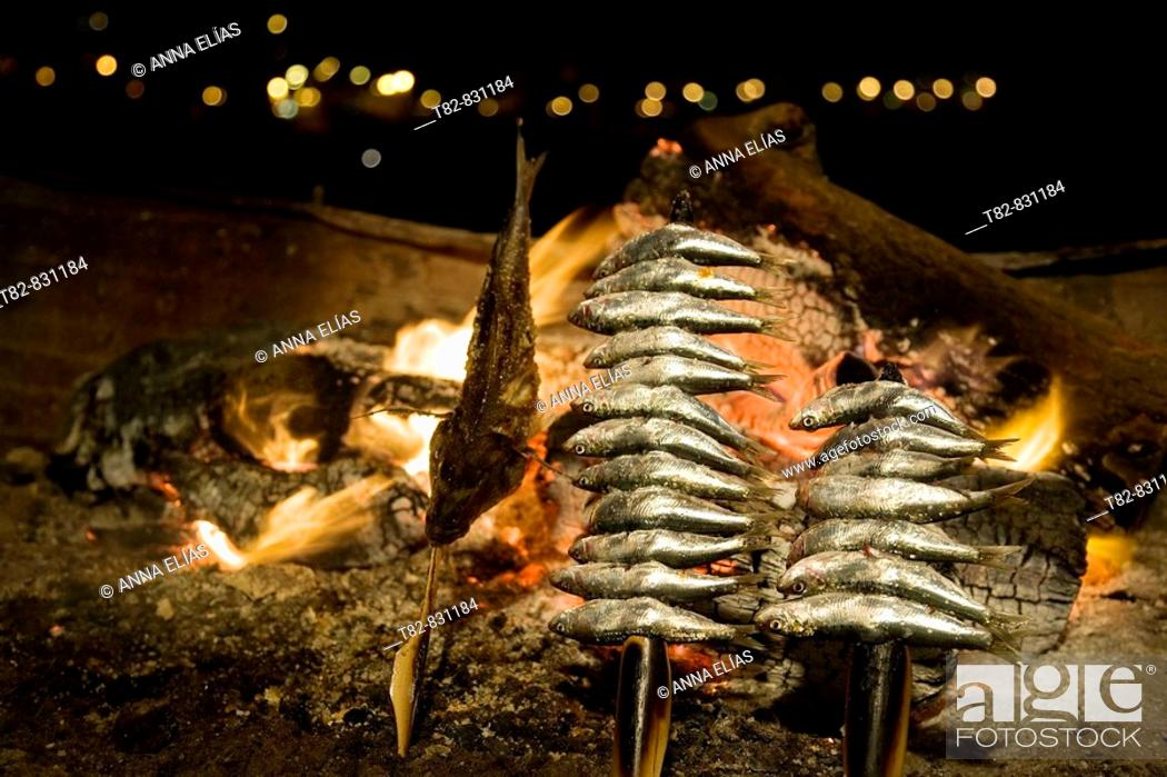 Stock Photo: Grilled sardines on the beach. Malaga, Andalucia, Spain.
