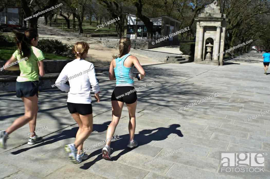 Stock Photo: Three girls running in a park of Santiago de Compostela. Galicia, Spain.