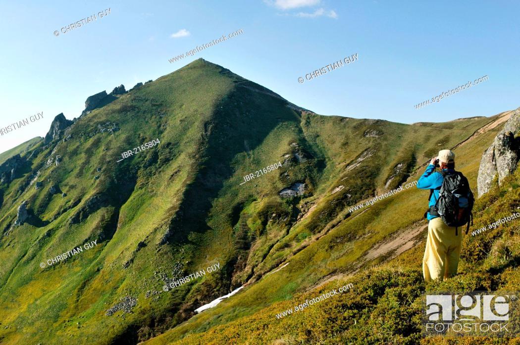 Stock Photo: Hiker in the Massif du Sancy, Parc Naturel Regional des Volcans d'Auvergne (Regional Nature Park of the Volcanoes of Auvergne), Monts Dore, Puy de Dome, France.