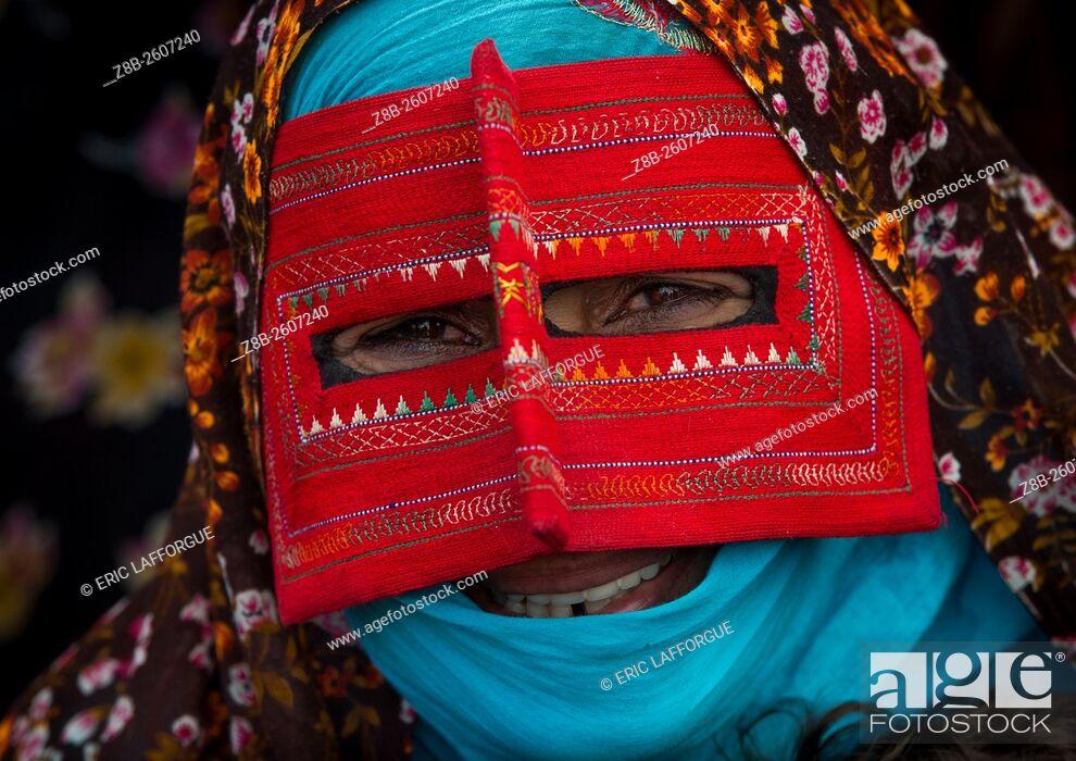 Stock Photo: Iran, Hormozgan, Minab, a bandari woman wearing a traditional mask called the burqa at panjshambe bazar thursday market.