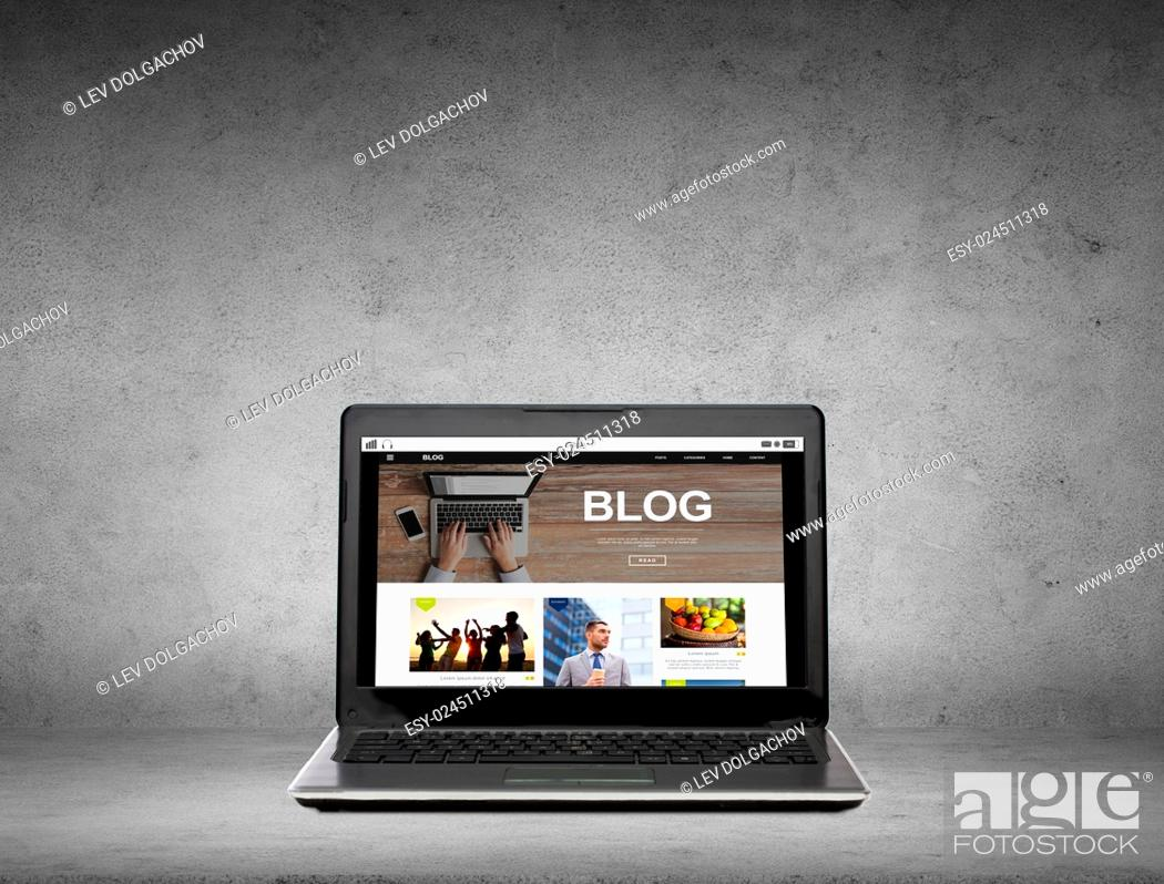 Stock Photo: technology, mass media and internet concept - laptop computer with blog web page on screen over gray concrete background.