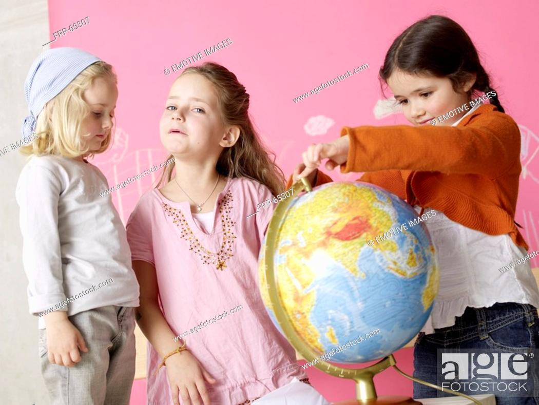 Stock Photo: Girl with a globe.