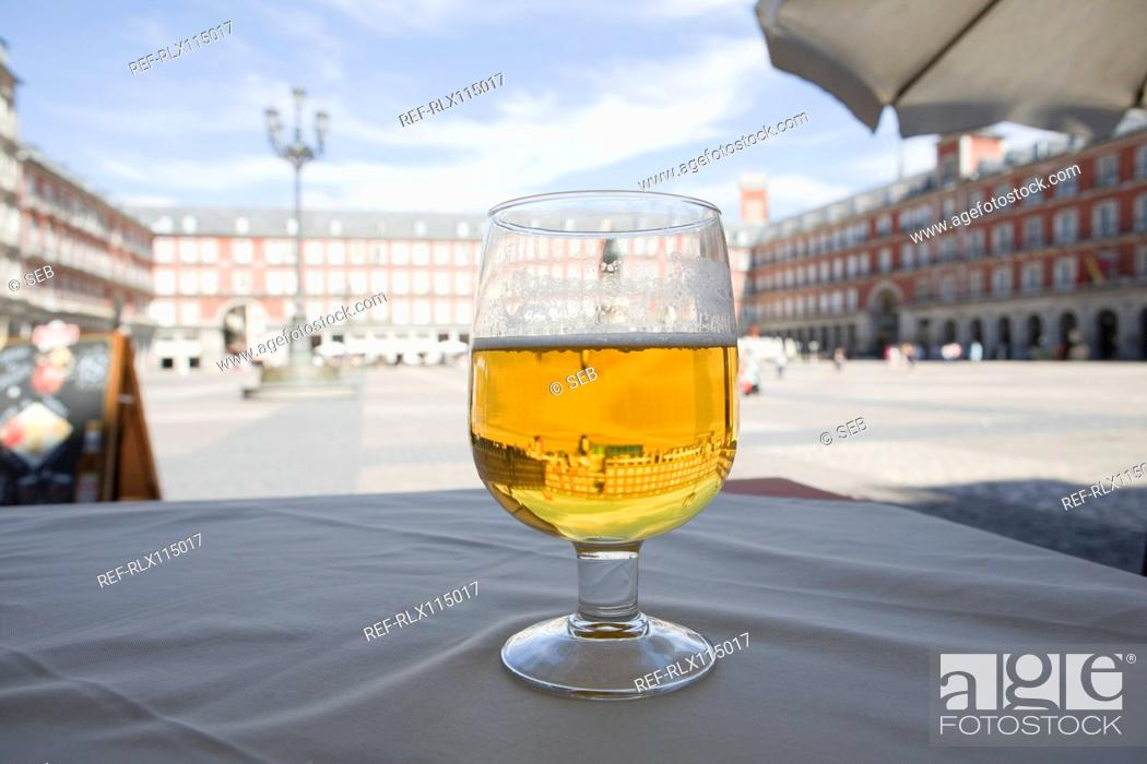 Stock Photo: Beer glass on cafe table, Plaza Mayor, Madrid, Spain.