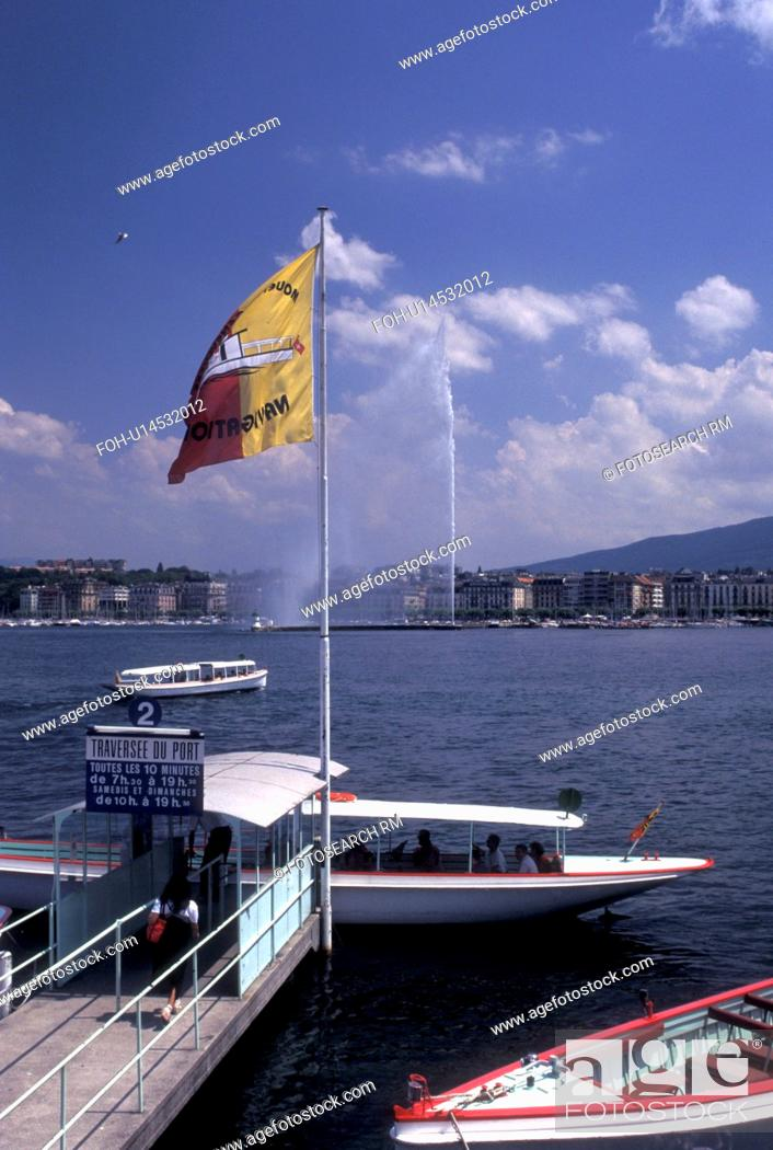 Imagen: water taxi, Geneva, Switzerland, Lake Geneva, Water taxi loading passengers at the dock on Lac Leman in Geneva. View of Jet d' Eau in the background.