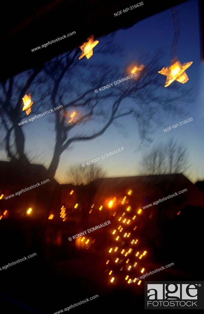 Stock Photo: View from a window decorated to celebrate Christmas, Sweden.