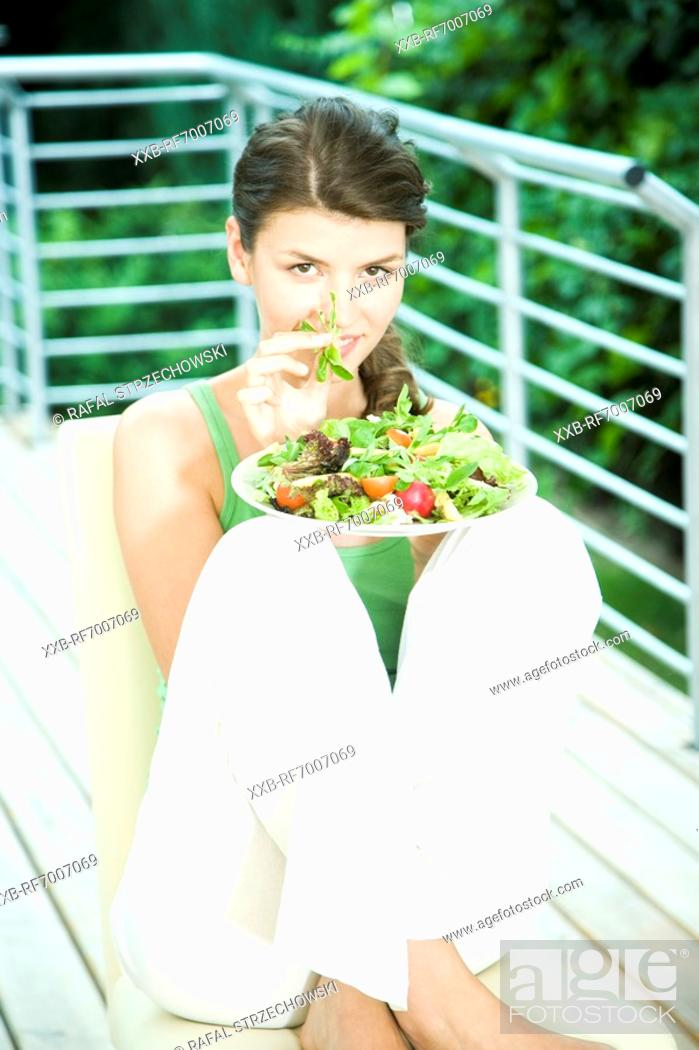 Stock Photo: Woman eating salad.