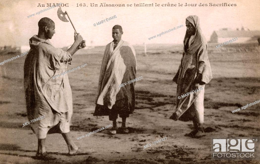 Stock Photo: A member of the snake charmers cult The Aissaoua Brotherhood ceremonially cuts his head on the 'Day of Sacrifices' a ritual of self-mutilation.