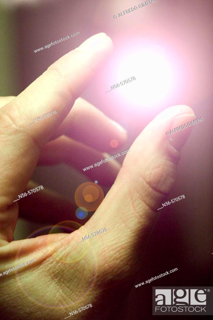 Stock Photo: Fingers holding light.