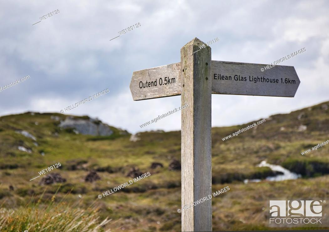 Stock Photo: Rustic wooden sign to Eilean Glas Lighthouse and Outend, Isle of Scalpay, Outer Hebrides, Scotland.
