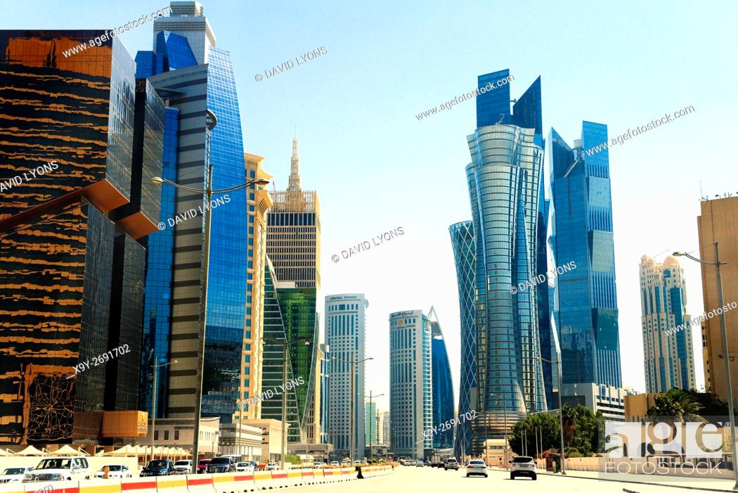 Stock Photo: Central Doha, Qatar. Iconic high rise on Majlis Al Taawon St. include Golden Bay Tower, Palm Twin Tower and Islamic Bank Tower.