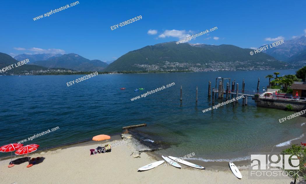 Stock Photo: The ship dock at San Nazzaro with a view of the Swiss Alps- Lake Maggiore, Locarno, Ticino, Switzerland.