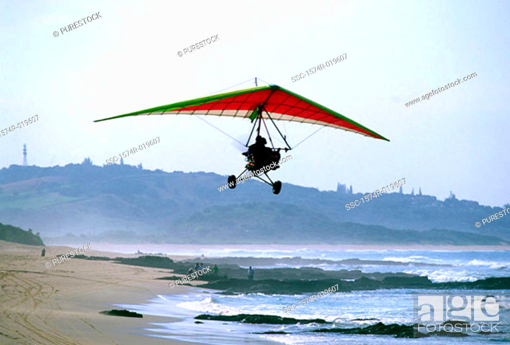 Stock Photo: Low angle view of a person flying an ultralight.