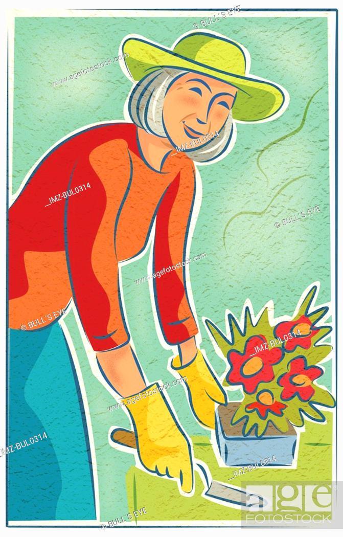 Stock Photo: An elderly woman potting flowers.