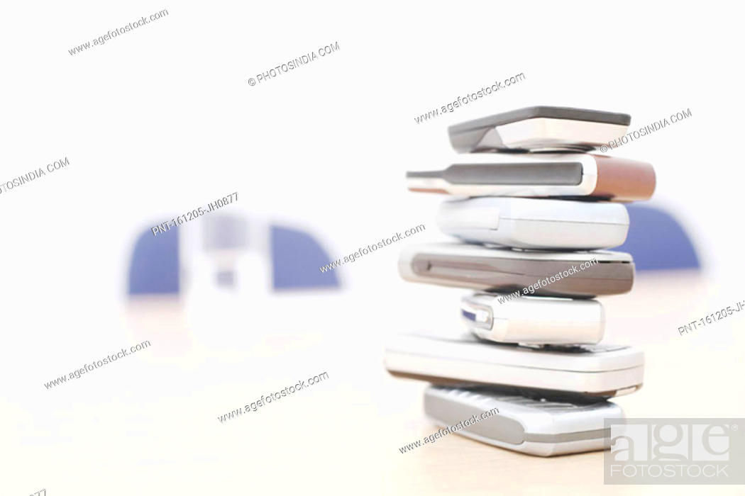 Stock Photo: Close-up of a stack of mobile phones.