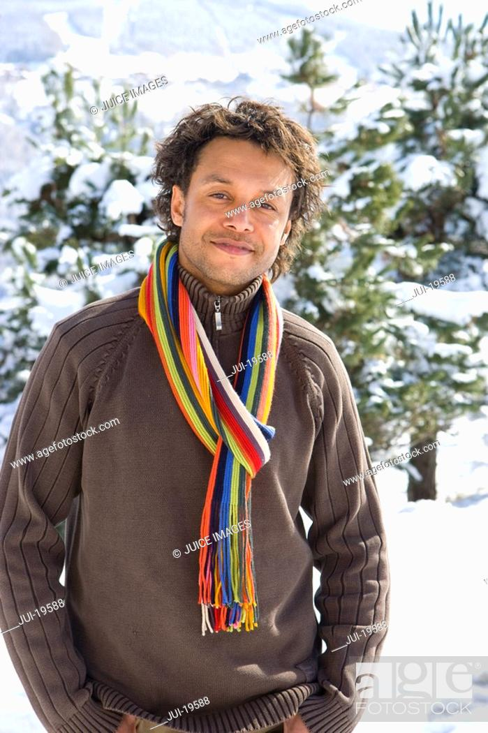 Stock Photo: Portrait of mature mixed race man in winter setting.