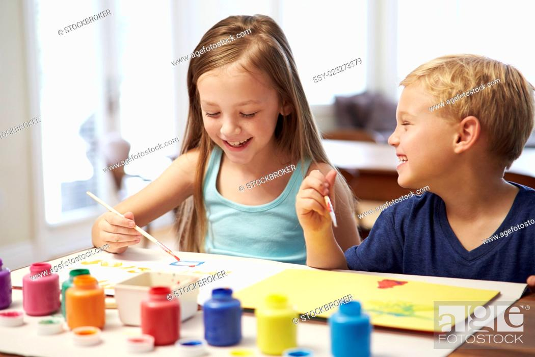 Stock Photo: Two Children Painting Picture At Home.