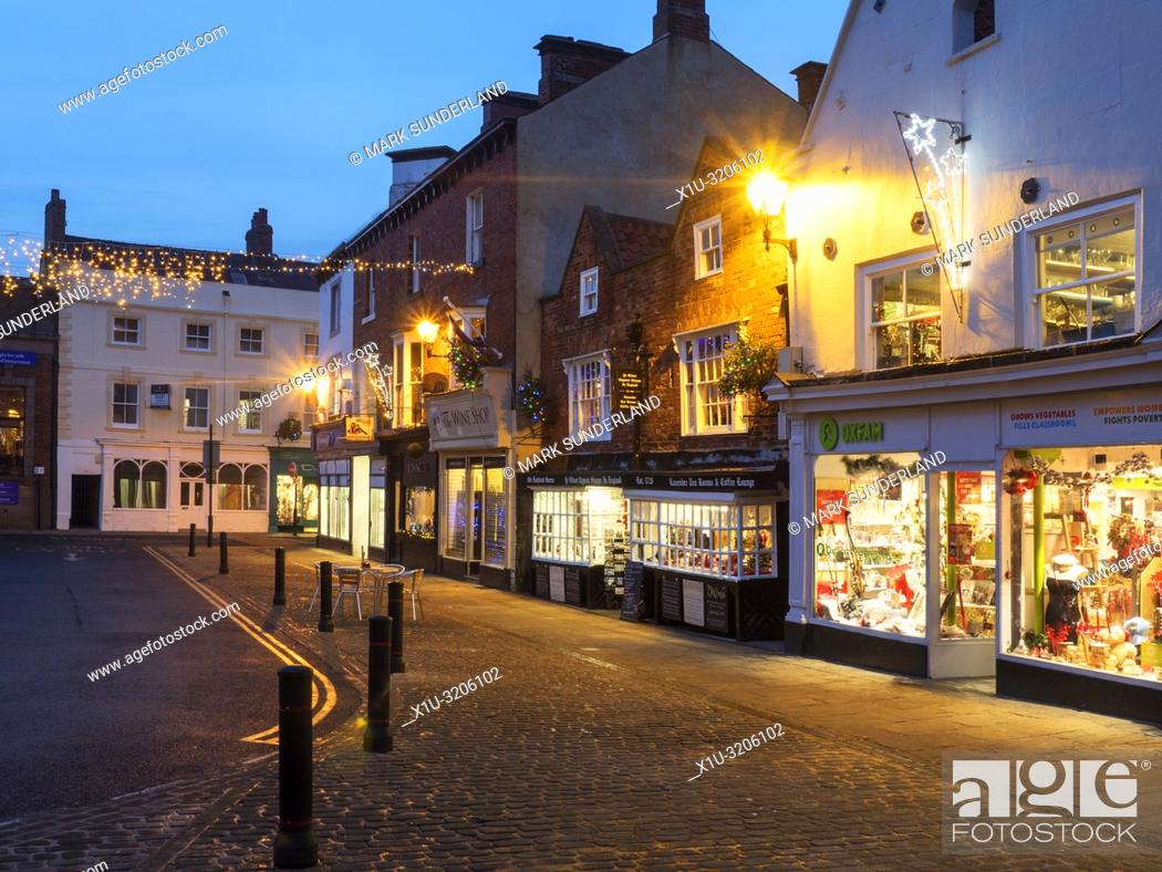 Stock Photo: Christmas lights and the Oldest Chemist Shop in England in the Marketn Place at Knaresborough North Yorkshire England.