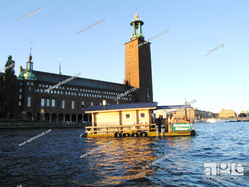 Stock Photo: A sauna boat floats in downtown Stockholm next to city hall, while passengers take a dip in the famously clean waters of the capital.