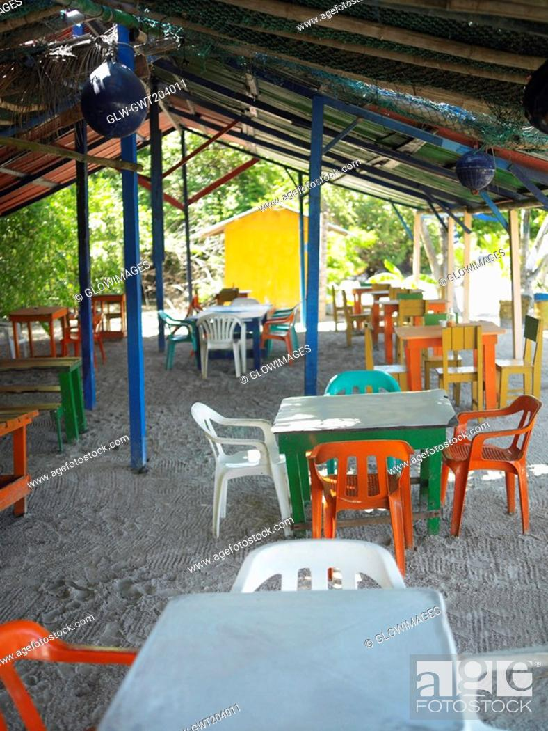 Stock Photo: Empty tables and chairs in a restaurant, Providencia, Providencia y Santa Catalina, San Andres y Providencia Department, Colombia.