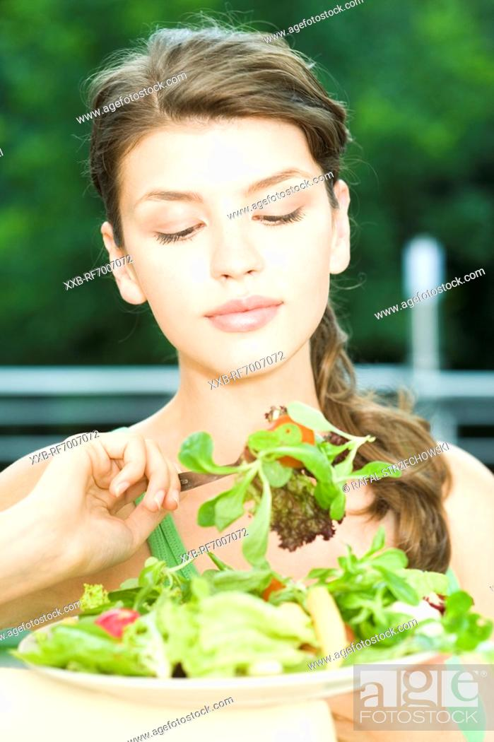 Stock Photo: Woman eating salad.