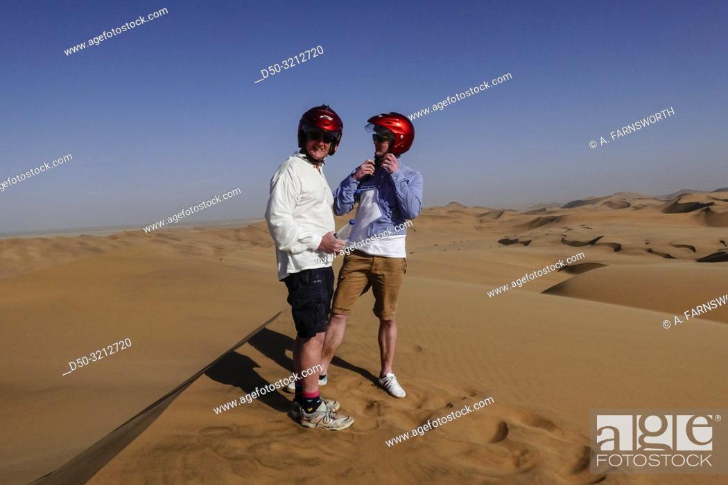 Stock Photo: Swakopmund, Namibia Quad riding in the desert sand dunes.