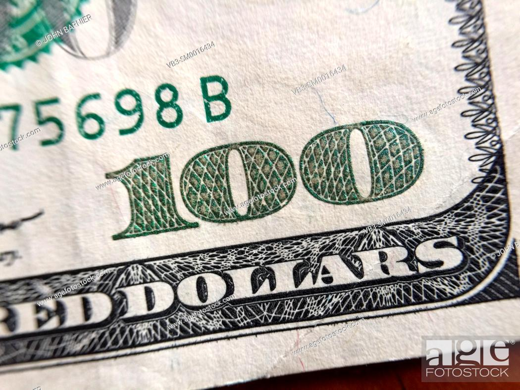 Stock Photo: Closeup of the number 100 in the corner of a $100 bill.