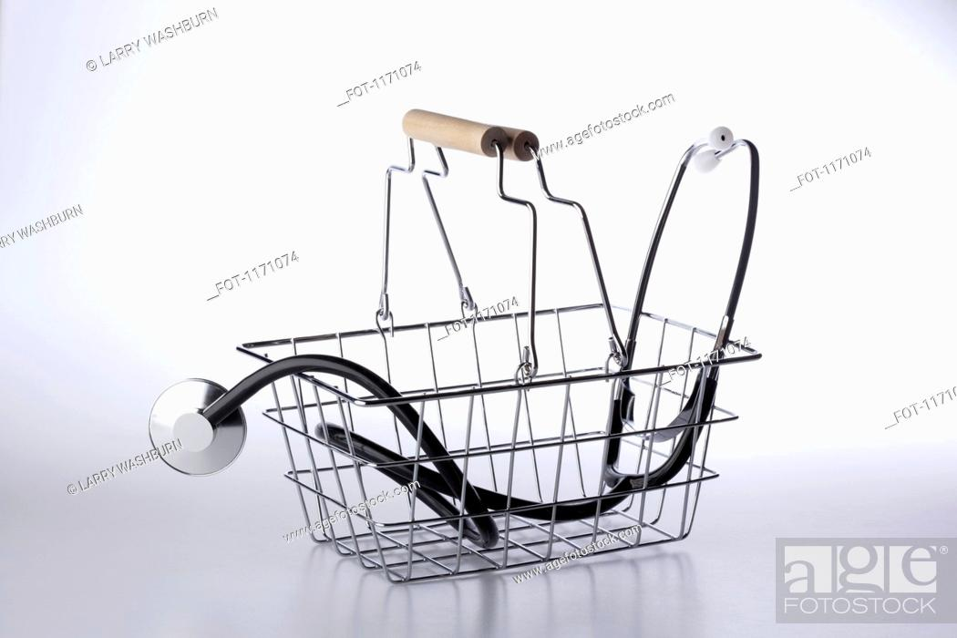 Stock Photo: A shopping basket with a stethoscope in it.