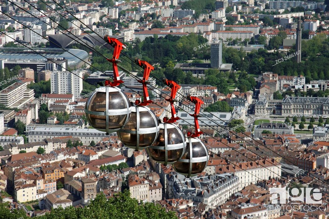 Stock Photo: City of Grenoble with les bulles, cable car in the city. Grenoble, Isere, Auvergne Rhone Alpes, France.