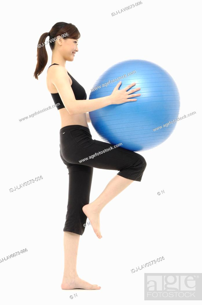 Stock Photo: Woman exercising with fitness ball.